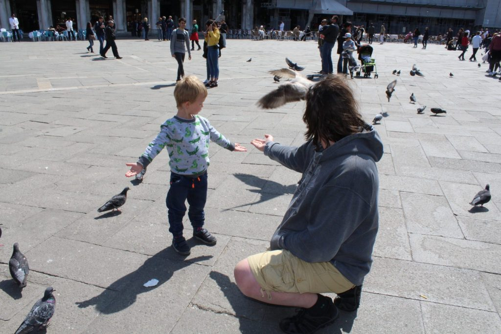 Feeding the pigeons on Saint Mark's square
