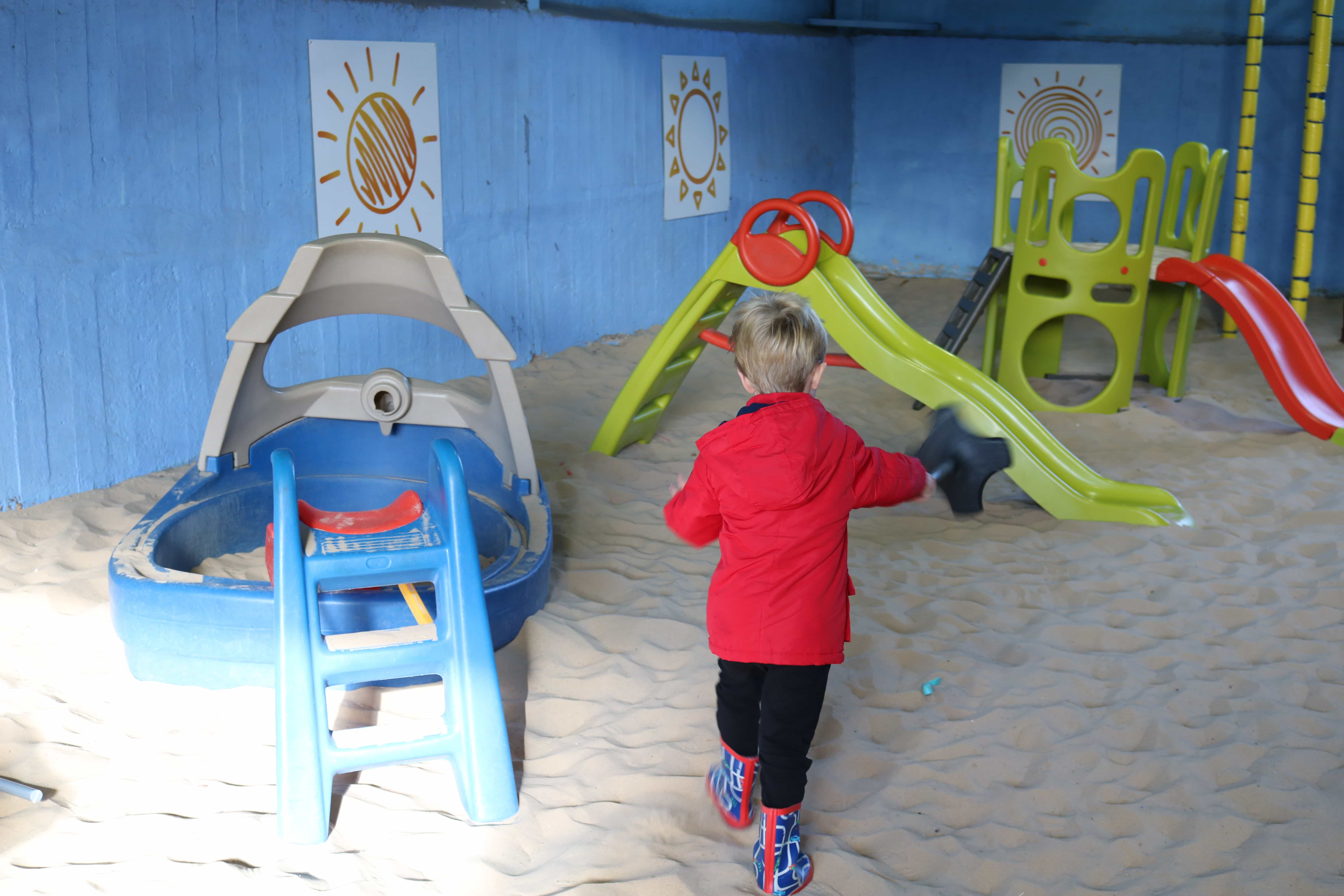Playing in the sand barn