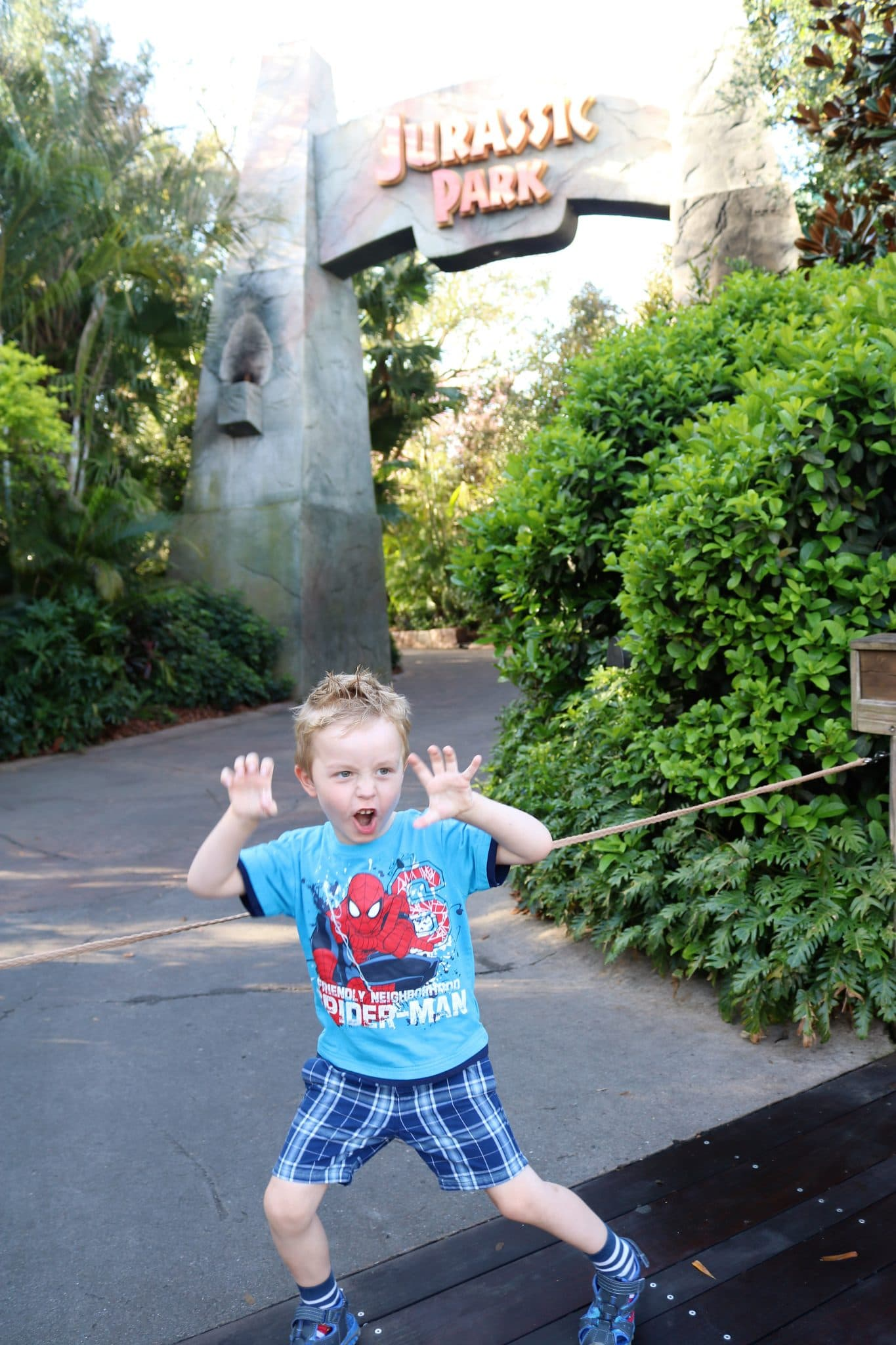 Waiting at the rope drop by Jurassic Park