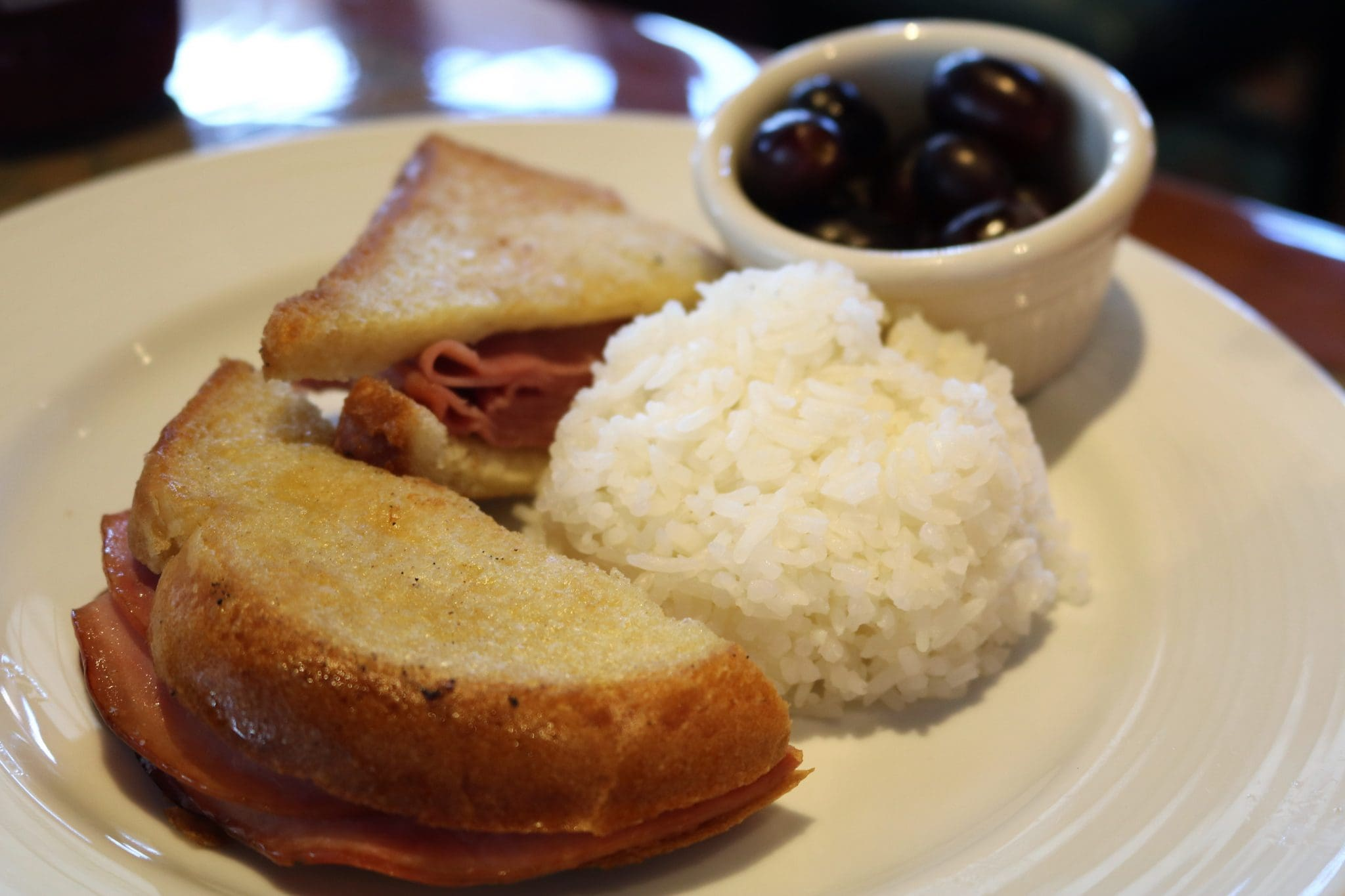 Kid's grilled ham sandwich with rice and grapes