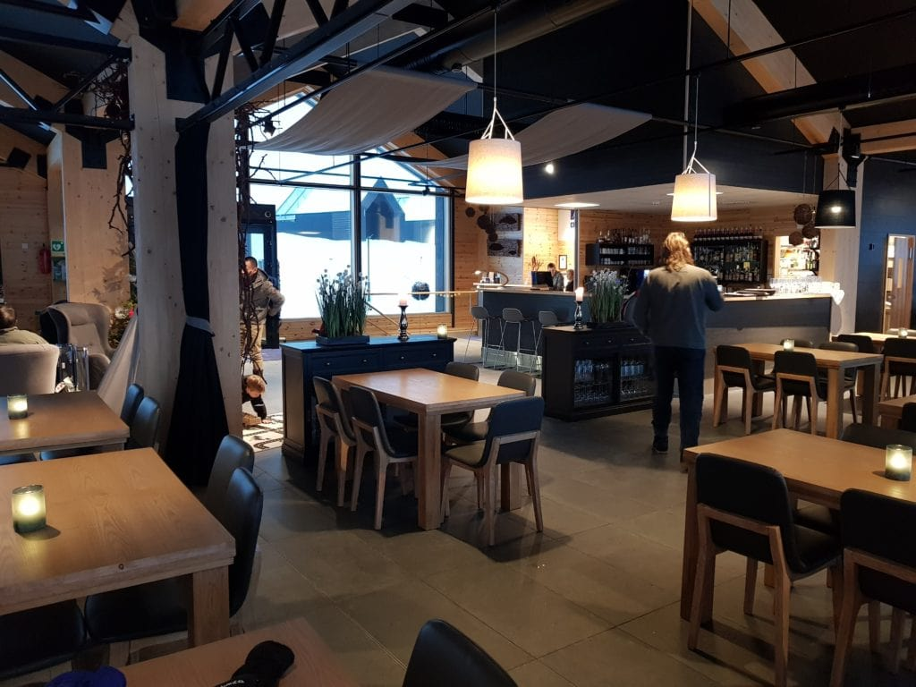 A view of part of the eating area, looking over to the bar