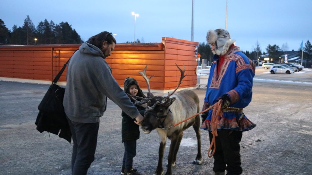 Saying hello to the reindeer at the airport