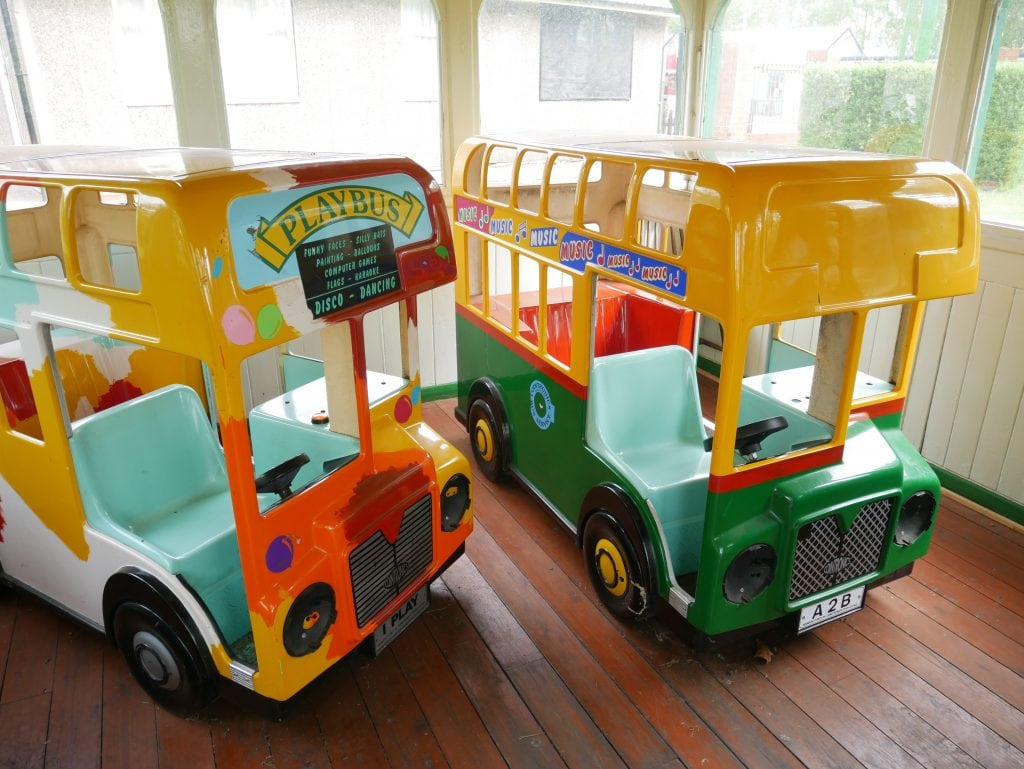 The two play buses next to the out of action playground