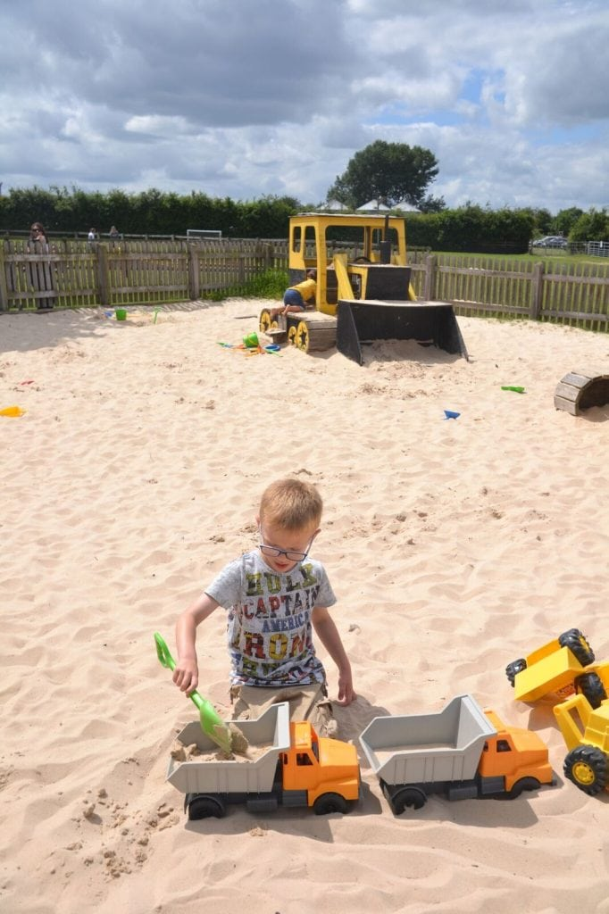 Giant sandpit with diggers