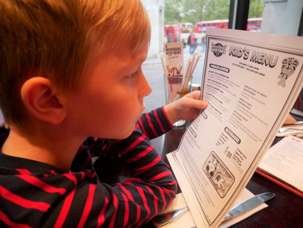 Surveying the kids menu at Hard Rock cafe London